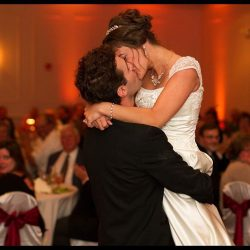 couple kisses at their wedding