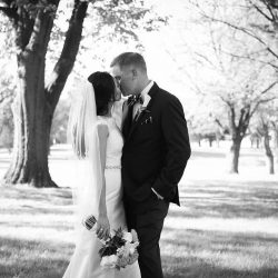 black and white groom and bride share a kiss