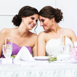 bride shares a moment with maid of honor