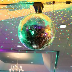 disco ball spins above dance floor