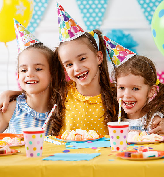 girls smiling at a children's birthday party